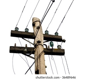 Top of an old-fashionded wood pylon with muddled wires in front of a white background.