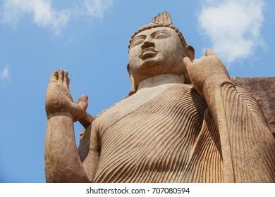 Top part of Avukana statue is a standing statue of the Buddha. Sri Lanka, Kekirawa