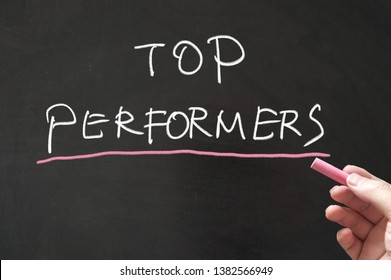Top performers concept words written on blackboard