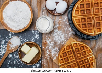 Top photo of ingredients for Viennese waffles, waffle maker, ingredients for cooking on the table
