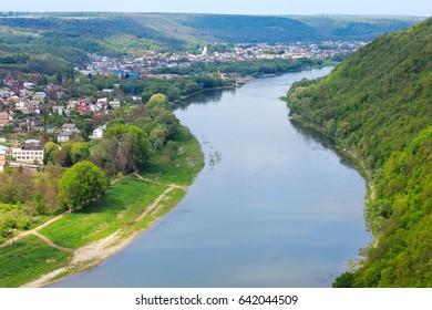 Top picturesque view of the spring Dnister river bend canyon and famous Ukrainian Zalischyky town. Ternopil region, Ukraine, Europe.