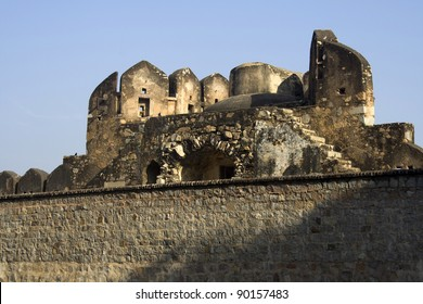 Top portion of the Fort seen behind wall, Jhansi, Uttar Pradesh, India, Asia
