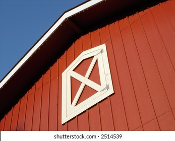 Top of a red barn on a country farm.
