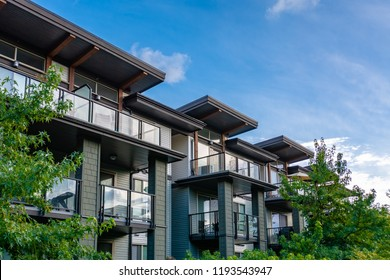Top of residential building on blue sky background