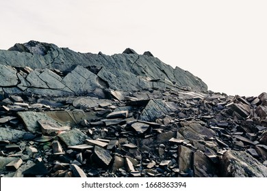 The top of a rocky mountain range. Gray flat stones. Rocky rock