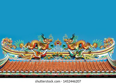 Top roof of the Chinese golden dragon pavilion in the public temple on blue sky background