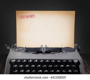 Top secret document in old typewriter.