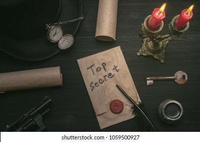 Top secret message document. Forbidden information. Detective agent desk table concept background. Secret agreement. The key to unraveling.