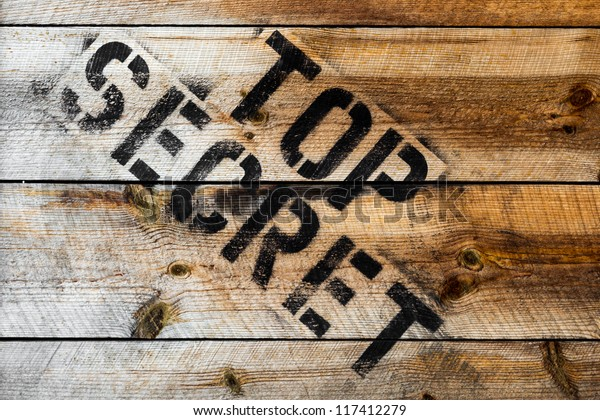 Top Secret stamp on wooden background or wooden box
