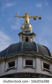 Top section of the dome and statue of lady justice on the old Bailey in London, UK.