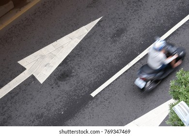 Top shot of blur motion motorcycle on road during rush hour