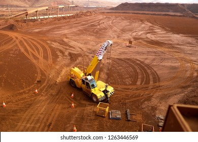 Top shot of rigger inspecting crane lifting chain equipment prior to used construction mine site, Perth, Australia