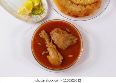 Top shot of traditional indian korma, Famous  pakistani food, Ramadan iftar meal, Diwali or christmas party dinner, Chicken qorma.