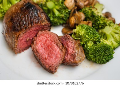 Top Sirloin Beef Steak Cooked Medium Rare Served with Steamed Broccoli