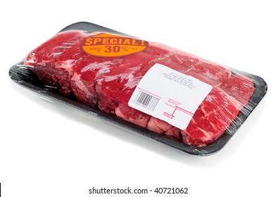 Top Sirloin Steak Roast In A Supermarket Packaging, Isolated On A White Background