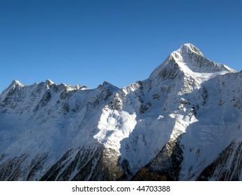Top of a snow white glacier in the Alps