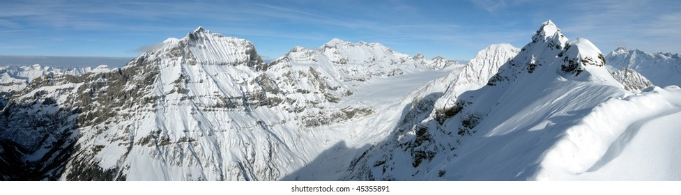 Top of a snow white glacier in the Alps, panorama