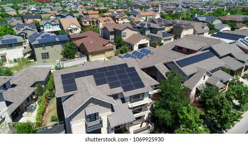 Top Solar panel rooftop one the leading renewable and sustainable energy Efficiency neighborhood in East Austin, Texas the Mueller suburb is covered in rooftop solar energy for a clean Earth Day