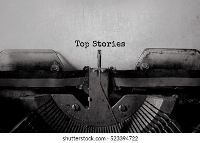 Top Stories typed words on a vintage typewriter