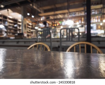 Top of table with Bar Restaurant blurred background with Bartender
