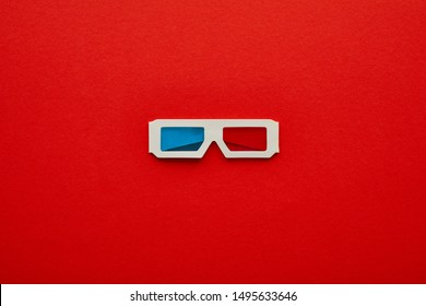 top view of 3d glasses on red background