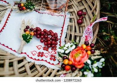 Top view of the accessories of the bride in basket: earrings, bracelet, garter,