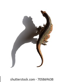 top view acrocanthosaurus toy with shadow on a white background