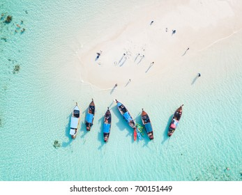 Top view or aerial view of Beautiful crystal clear water and white beach with long tail boats in summer of tropical island named Koh Lipe in Satun,Southern Thailand.