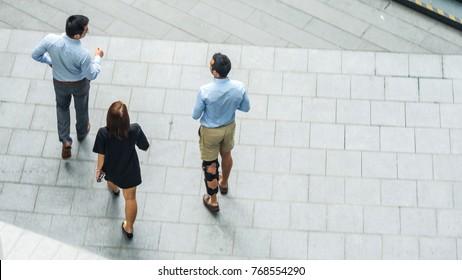 top view aerial of business people walk in pedestrian street