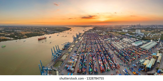 Top view aerial of Cat Lai container harbor, center Ho Chi Minh City, Vietnam with development buildings, transportation, energy power infrastructure.