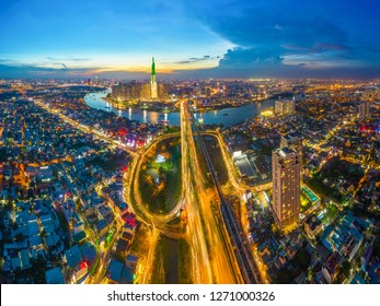 Top view aerial of center Ho Chi Minh City and Saigon bridge with development buildings, transportation, energy power infrastructure. Financial and business centers in  Vietnam. View from District 2