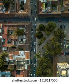 Top view aerial from drone of Antigua town with church, cars, streets and houses in Guatemala