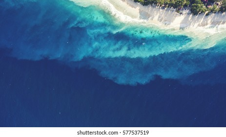 Top view aerial drone photo of unspoiled, deserted, powder-white sandy seashore with crystalline water. One of the most beautiful beaches in the world for travel website or journey blog background