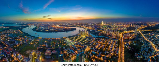 Top view aerial of a Ho Chi Minh City, Vietnam with development buildings, transportation, energy power infrastructure. Saigon river and center city view from district 2