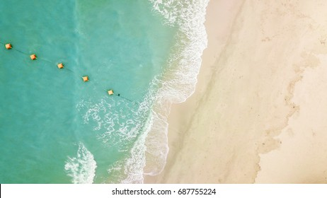 Top view aerial image from drone of an stunning beautiful sea landscape beach with turquoise water with copy space for your advertising text
