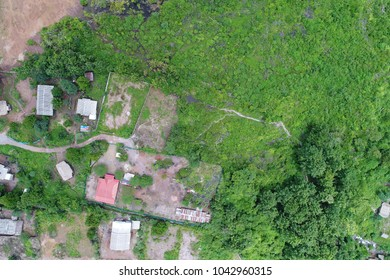 Top view or Aerial view of landscape village countryside and green field, Thailand on green trees nature and mountain background - Take a photo by drone camera