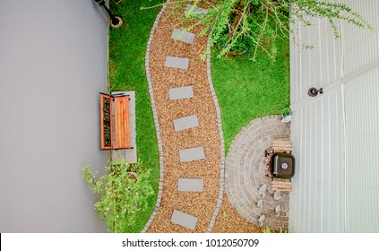 Top view aerial photo from flying drone of Stone walkway winding in garden