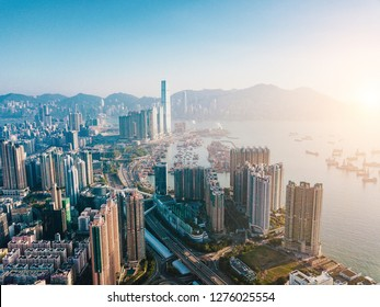 Top view aerial photo from flying drone of a developed Hong Kong city with modern skyscrapers with contemporary design. China town with business and financial centers and road with cars - Image