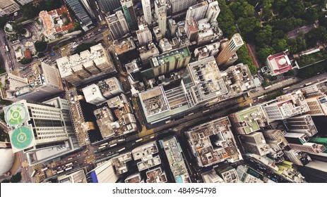 Top view aerial photo from flying drone of a developed China metropolitan with office skyscrapers and business center. HongKong city with tall buildings and development transportation infrastructure