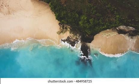 Top view aerial photo from flying drone of a beautiful paradise beach in Thailand with tropical plants and sea with blue water. Beauty nature in Indian Ocean. Wallpaper for travel website or blog