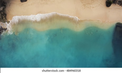 Top view aerial photo from flying drone of an amazing seascape with paradise beach and sea with turquoise water. Summer vacation holidays in Thailand. Perfect website background with copy space area