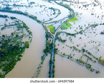 Top view Aerial photo from flying drone.Flooded rice paddies.Flooding the fields with water in which rice sown. View from above.