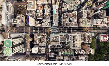 Top view aerial photo of a Hong Kong Global cityscape with development buildings, transportation, energy power infrastructure. Financial and business centers with infographics wireless connection icon