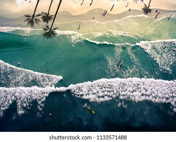 Top view aerial photograph of waves in New Smyrna Beach, Florida.
