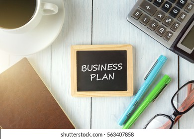 top view of AFFILIATE MARKETING written on the chalkboard,business concept.chalkboard,notebook,calculator,pen,glasses,coffee on the wooden desk.