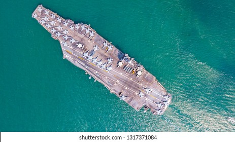 Top View Aircraft Carrier are sailing in the ocean