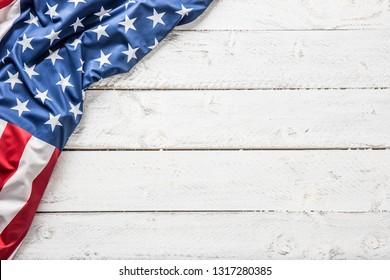 Top of view American flag on white wooden table.