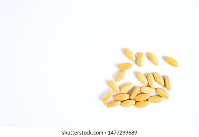 Top view amount vitamin pills in yellow on white background . Vitamin herbes supplemental and healthcare product concept