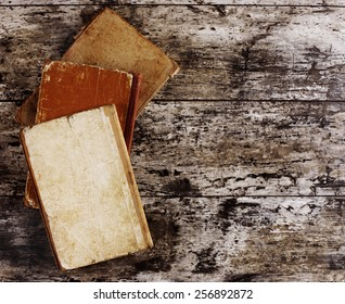 top view of ancient books on wooden table