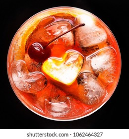 Top view of an Aperol Spritz with heart shaped ice cubes.